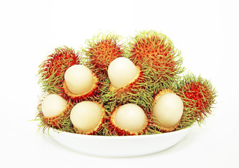 Rambutans on a plate - stock image