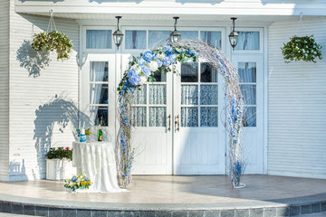 Wedding arch of vines with flowers