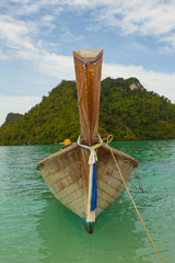 Traditional Thai long tail boat with thai island background