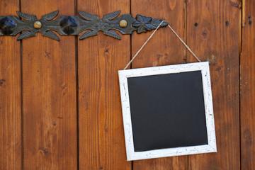 Signboard hanging on wooden door