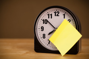 Empty post-it note sticked on alarm clock