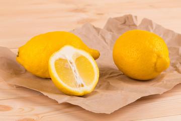 Ripe lemons on paper.