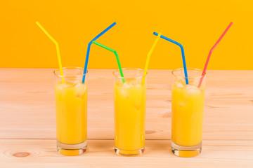 Glasses full of orange juice.