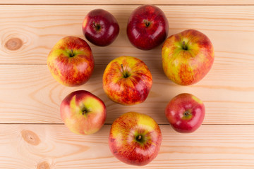 Fresh red apples on wood background.