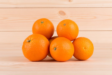 Fresh oranges on wood table.