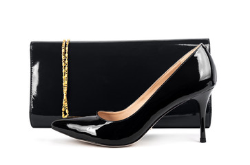 Beautiful  black shoes with clutches on white isolated backgroun