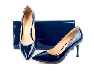Beautiful  blue shoes with clutches on white isolated background