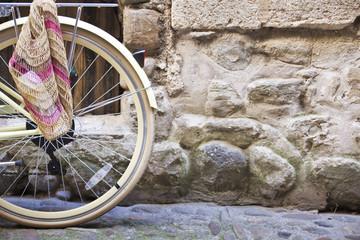 Bicycle wheel on a cobblestone street