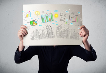 Businessman holding a paper with charts and cityscape in front o
