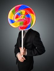 Businessman holding a lollipop