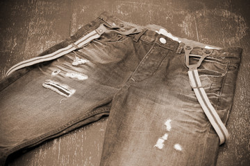 holey jeans with suspenders, photo toning in sepia