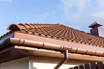 Red tiled roof with gutter and chimney