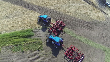 Up over  agricultural tractors. Aerial