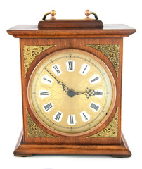 An old fashioned, wooden clock.