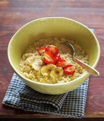 Porridge with banana and strawberry in a bowl