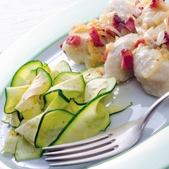 Silesian dumplings with Bacon and zucchini