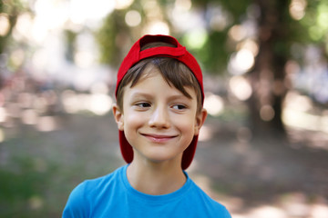 Little boy in cap look away