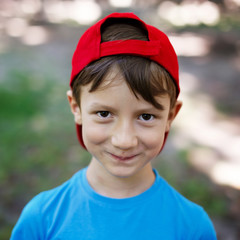 Little boy in red cap