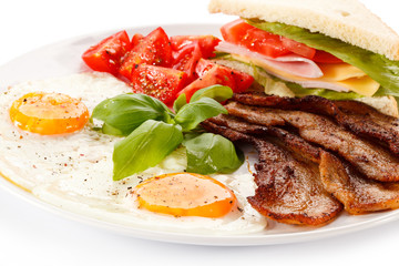 Breakfast - toast, egg, bacon and vegetables