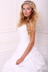beautiful bride with blond hair in wedding dress