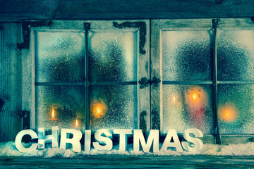 Christmas: Weihnachtlicher Holz Hintergrund mit Kerzen