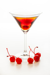 Manhattan cocktail garnished with a cherry