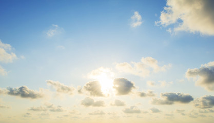 the sun's rays illuminate the sky above the horizon