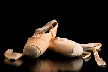 Pair of ballet shoes on a dark background