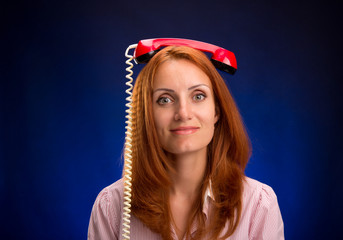 Redhead woman with phone