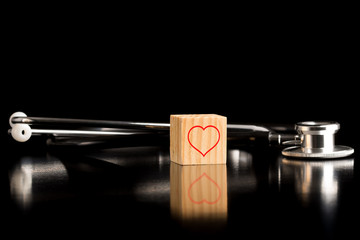 Heart Wooden Block in front of Stethoscope
