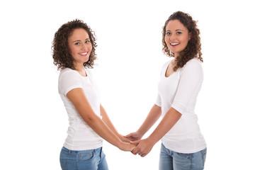 Konzept Teamwork oder Freundschaft: zwei junge Frauen