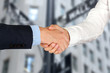 Close-up image of a firm handshake  between two colleagues in of