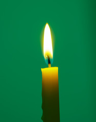 yellow Candle on green background