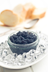 black caviar in jar