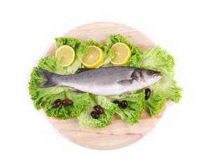 Fresh seabass fish on lettuce.