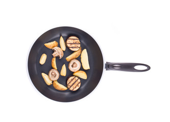 Frying pan with potatoes and mushrooms.
