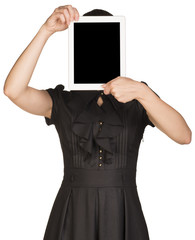 Girl in dress covers her face with the tablet
