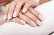 Beautiful woman's nails with french manicure. - 70159154