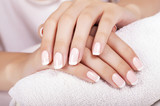 Beautiful woman's nails with french manicure. - 70159155