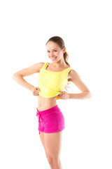 Happy fitness young woman showing a flat stomach in sportswear