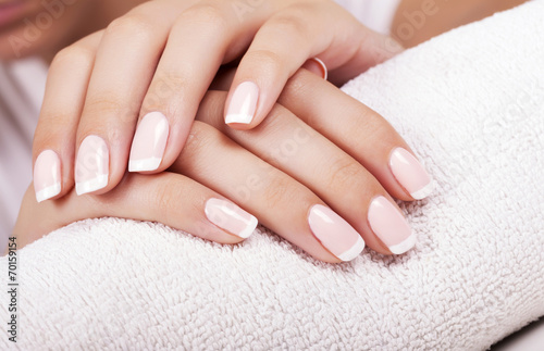Beautiful woman's nails with french manicure. Poster