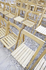 Wooden chairs in a concert