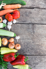 Fresh vegetables on rustic wooden background
