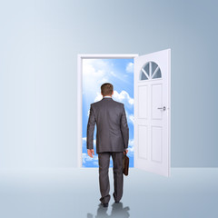 Businessman in suit with briefcase stepping through door