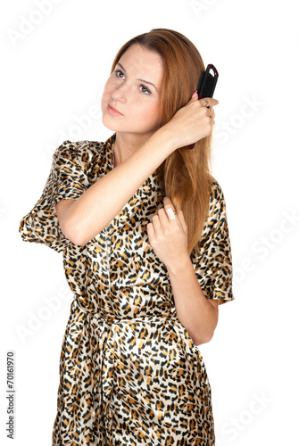 canvas print picture Beautiful young blonde with comb