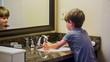 Boy washing hands in the bathroom
