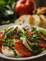 Caprese salad with tomatoes, basil, mozzarella cheese, and bread