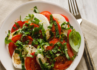 Caprese salad with tomatoes, basil, and mozzarella cheese