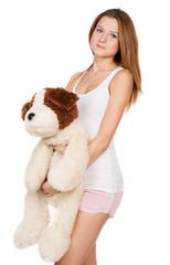 Beautiful girl hugging a teddy dog