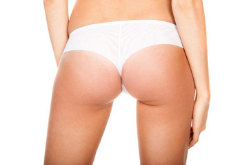 Buttocks in a white panties